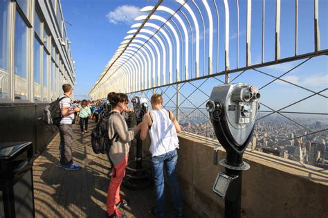 Tourists On The Empire State Building Observation Deck In
