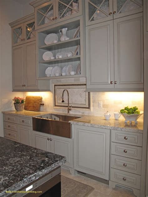 Shelving above kitchen sink with bead board backing